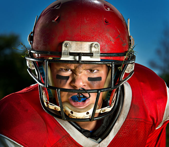 why do football players wear face paint
