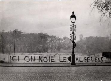 "The banner reads (translated): ""Here we drown Algerians"""
