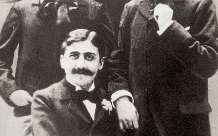 Proust (seated) with Lucien Daudet (right)