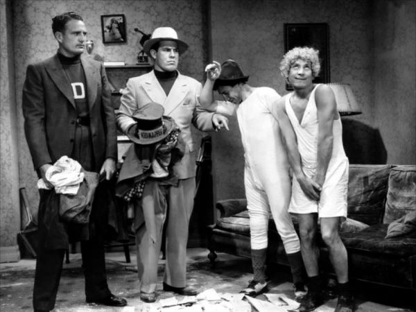Harpo Marx And His Habit Of Shedding His Clothing At